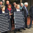 Members of the Birmingham pub bombings campaign group, Justice4the21, outside Birmingham Priory Courts where pre-inquest reviews were being held ahead of fresh hearings set to start in September