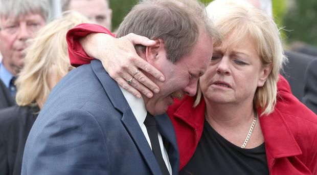 Dean McIlwaine's grief-stricken parents Karen and Rodney at the funeral of the 22-year-old at Carnmoney Presbyterian Church yesterday