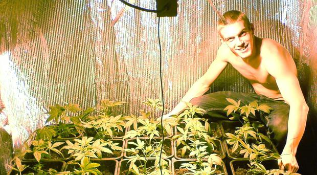 A photograph of the soldier-turned-terrorist posing with cannabis which was recovered from one of his memory cards