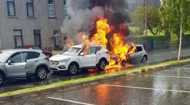 The two cars on fire yesterday following a crash in Dundrum