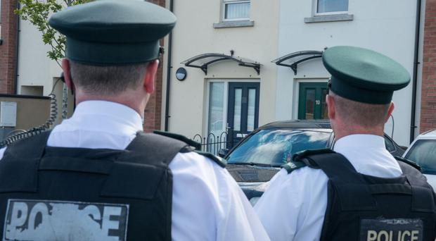 Police at the scene of the shooting in Racecourse Drive, Londonderry