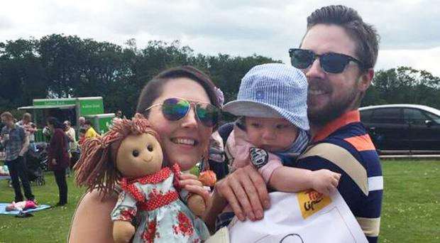 Claire and Kris with son Archie and the Matilda doll