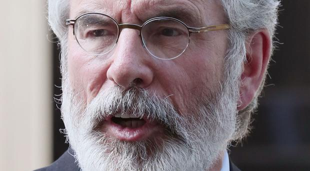 Gerry Adams said he would be willing to cancel his holiday and immediately restart powersharing talks if the DUP were willing to embrace Sinn Fein's rights agenda