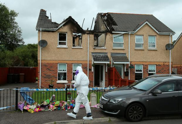 Forensic officers at the scene of the house fire in Lagmore where Jennifer Dornan died