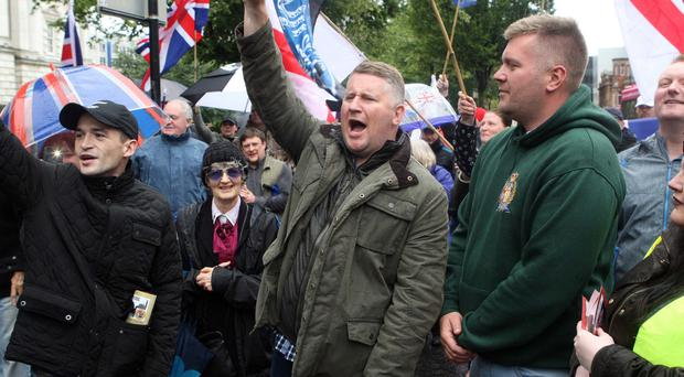Britain First leader Paul Golding (centre) at yesterday's rally outside Belfast City Hall