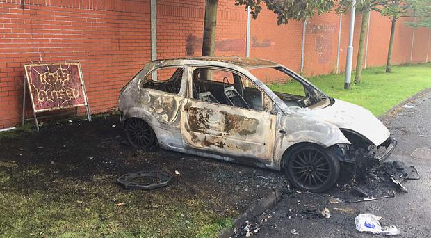 A burned-out car in the Markets area of Belfast