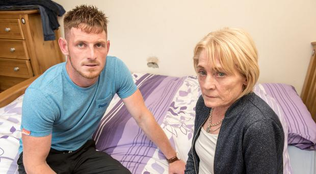 Mary Peoples with her son Ryan at their home at Melmount Villas in Strabane