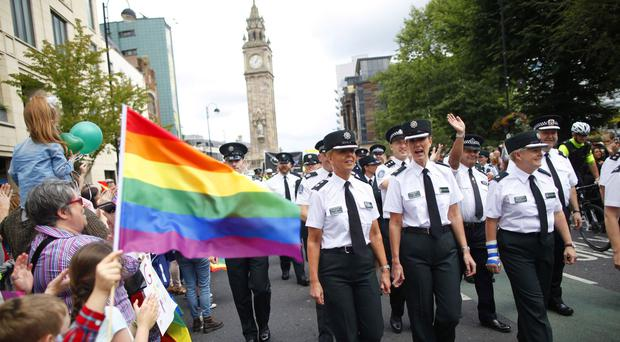 Members of the PSNI and Garda join the Pride parade as it made its way through Belfast city centre
