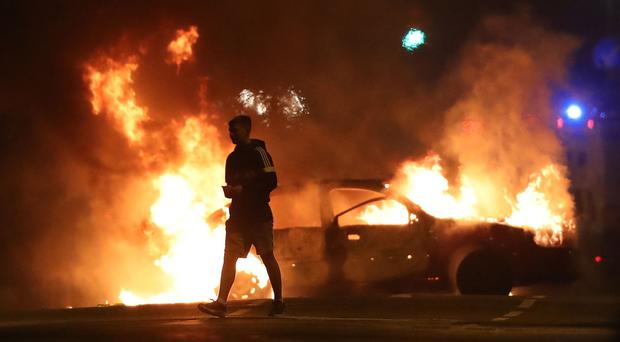 A car was set on fire in Belfast as disorder continued