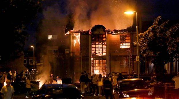 The burning Credit Union office building in the Divis area of the lower Falls in west Belfast