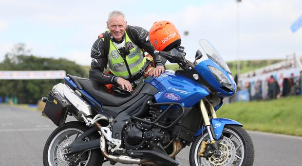 Dr Fred MacSorley with his trusty motorbike