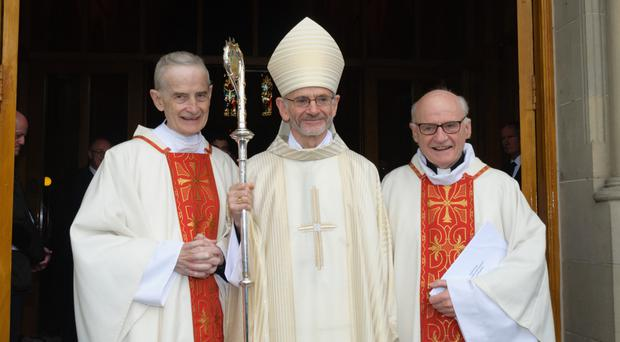 Bishop Alan McGuckian with his brothers Fr Michael (left) and Father Bernard, and (right) his ordination
