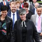 Civil partners Shannon Sickles (left) and Grainne Close and Christopher Patrick Flanagan (second left) and Henry Edmond Kane (right) arriving at the High Court in Belfast for the judgment on two landmark legal challenges against Northern Ireland's ban on gay marriage