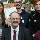 Northern Ireland education minister Peter Weir with students at Sullivan Upper School in Holywood as they received their A and AS-level results