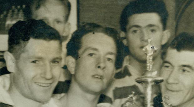 Charlie Tully (second left), Harry Walker, Eddie McMorran and manager Elisha Scott with the Irish Cup which Belfast Celtic won by defeating Glentoran in the 1947 final