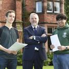 Mohammad Rashid (right) and Thomas Gillan with headmaster Mr Robert Robinson MBE