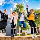 Kaja Olszewska , Kaitlyn Bradshaw, Jenni Cupples and Jasmin Higgins jump for joy after receiving their A-level results at Belfast Model School for Girls