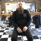 Barber Harry Preshur at his premises in Greenisland