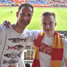 Matt Walker (left) meets a fan during a Russian Premier League game