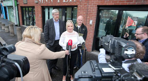 Sinn Fein's Michelle O'Neill and party colleagues John O'Dowd (left) and Paul Maskey speak to the press yesterday