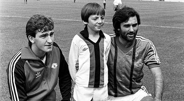 Northern Ireland 's Norman Whiteside (left) playing for Man Utd against club legend George Best (right), who turned out for Glentoran in a friendly, with mascot Stephen Chick