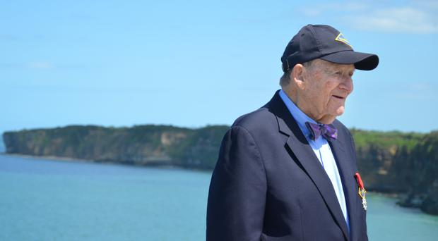 George G Klein on the cliffs at Pointe du Hoc this year, where he claimed to have landed on June 6, 1944