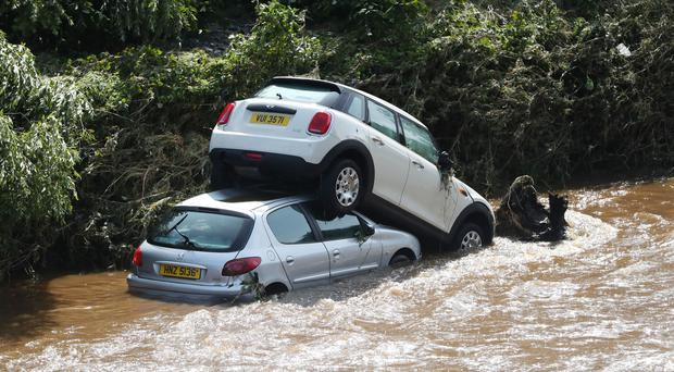 Cars washed into the River Faughan in Drumahoe, Londonderry, after heavy rain