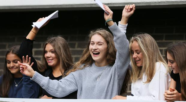 Pupils at Victoria College in Belfast celebrate after receiving their GCSE results