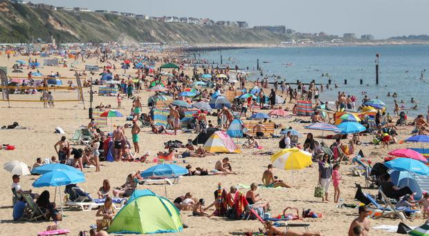 Bank holidaymakers flocked to the coast to soak up record temperatures