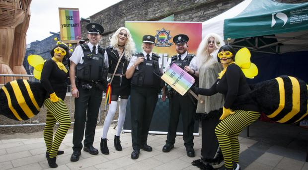 PSNI LGBT Network officers Constable Alan Benton, Chief Supt. Paula Hilman and Constable Paul Bloomer with Beeonce, Alexis Ireland, Annie Rose Devine and Honey Bee at Saturday's Foyle Pride parade