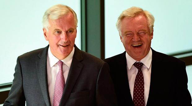 Brexit Minister David Davis (right) and the EU's chief Brexit negotiator Michel Barnier in Brussels yesterday