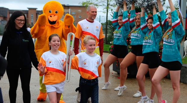 Belfast Giants cheerleaders welcome the arrival of the Queen's Baton Relay
