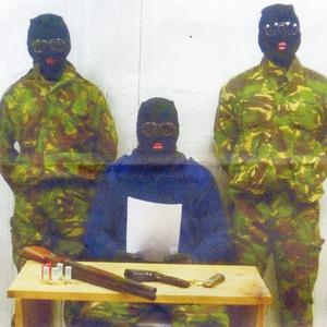 The image of three men in balaclavas which was issued to the Ulster Herald