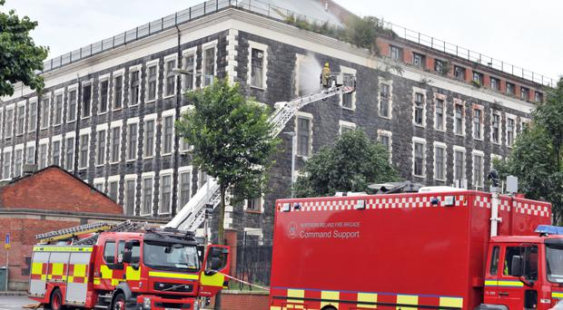 Firefighters deal with a major blaze at the old Ewarts Mill complex in north Belfast