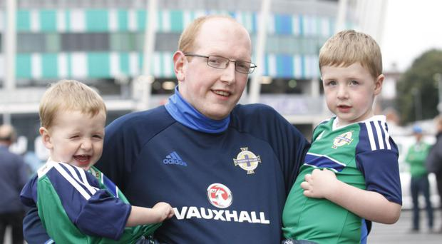 Jonathan Smyth and his two sons Theo and Alfie arriving for the game