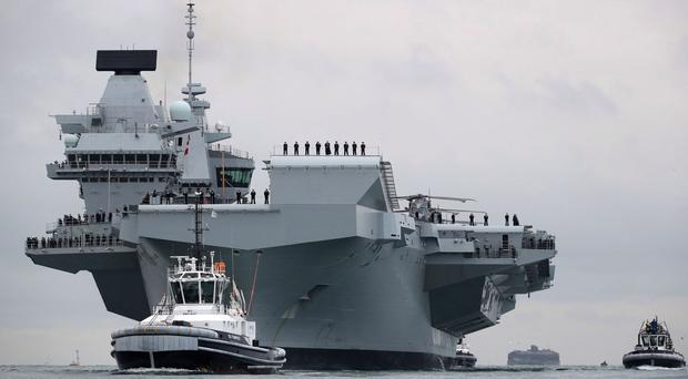 The Navy's biggest ever ship, HMS Queen Elizabeth, was built in blocks in six British cities, before being assembled in Rosyth (Royal Navy/PA)
