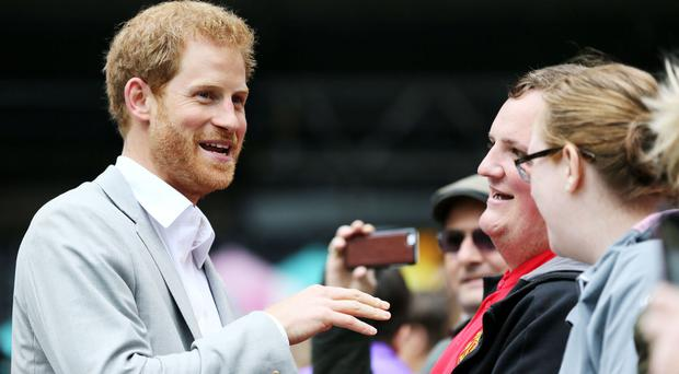 Prince Harry meets members of the public in Belfast during a visit to Northern Ireland