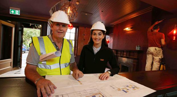 Laura McGillion, group marketing manager for 1 Oak Leisure Ireland Ltd, and Dermot Doyle, foreman with Oakleaf Contracts, oversee work on the new Playwright Bar