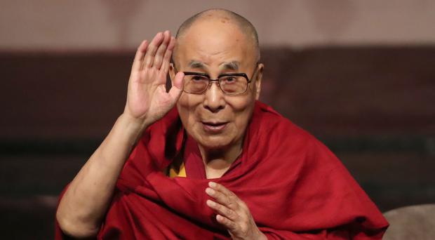 The Dalai Lama addresses a charity event during a visit to Londonderry