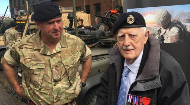 Norman Dickson with his new beret and Royal Engineers badge presented to him by Manny McCrea