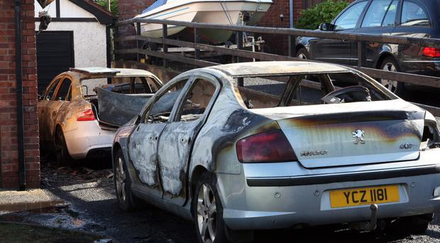 The two cars which were destroyed in an arson attack in Larne