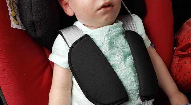 Weronika Martyniw in her specialist car seat which supports her head and body