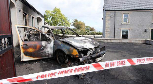 The property on the Brustin Brae Road in Larne where shots were fired after a vehicle was set on fire