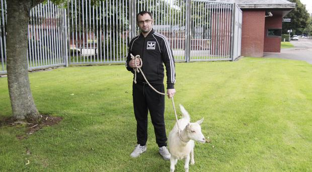 Andrew Meneice from Portrush outside Coleraine Magistrates Court with his pet goat