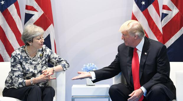 Theresa May asks Donald Trump to intervene in Northern Ireland trade dispute