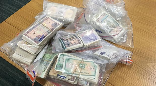 Bundles of cash seized by police