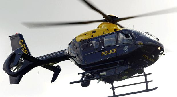 The alleged burglar was tracked through a wooded area using the police helicopter.