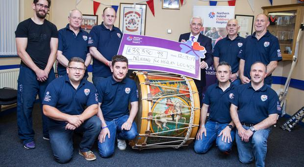 Representatives of LOL 423 present the cheque to hospice president Paul Clark