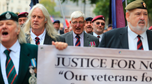 Former British soldier Dennis Hutchings (centre), who has been charged over the fatal 1974 shooting of John Pat Cunningham, takes part in a protest in London over Troubles prosecutions of Army veterans