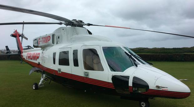 The helicopter belonging to the Trump corporation at Royal Portrush